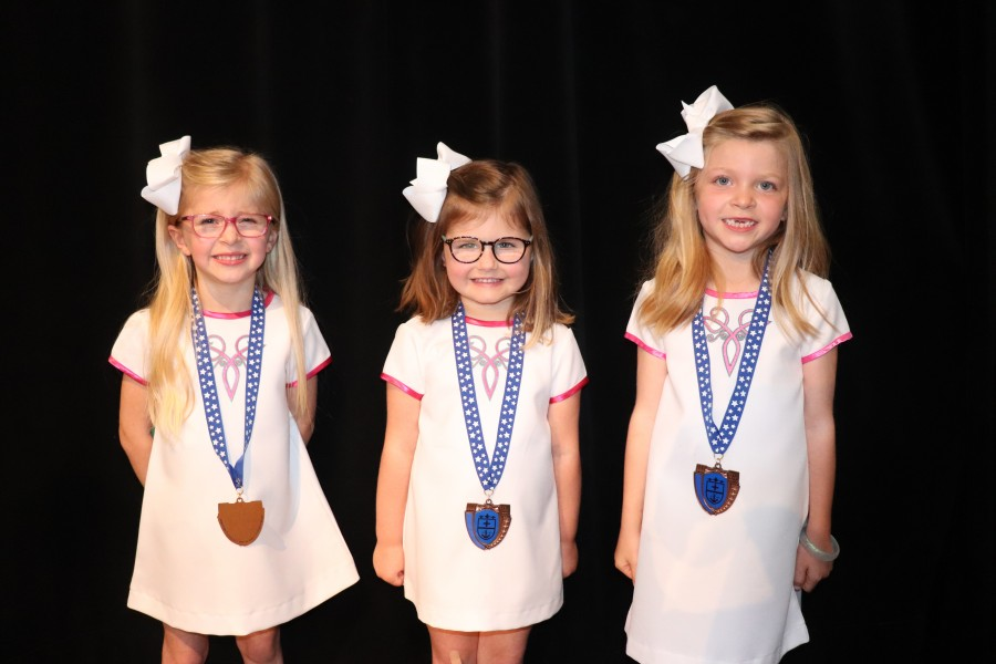 3 little girls with medals on
